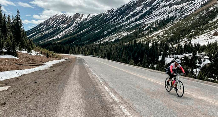 Lisa Monforton, ConnecTour group member, rides the road the Highwood Pass, at 2,206 metres, the highest elevation paved pass in Canada
