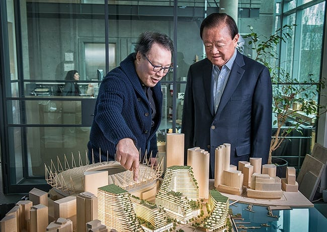 Singapore tycoon Oei Hong Leong with Vancouver architect James Cheng examine a model of the proposed Expo Gardens development in False Creek