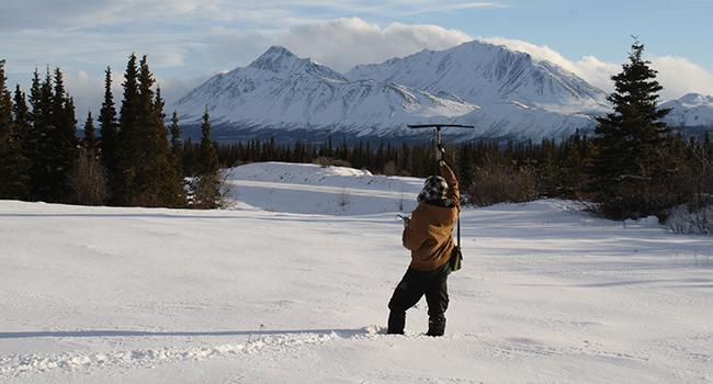Ecologist Michael Peers snowshoe hair telemetry