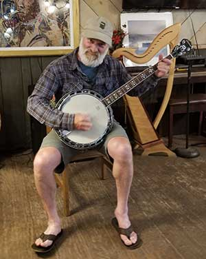 Playing the banjo in the Hotel Ymir